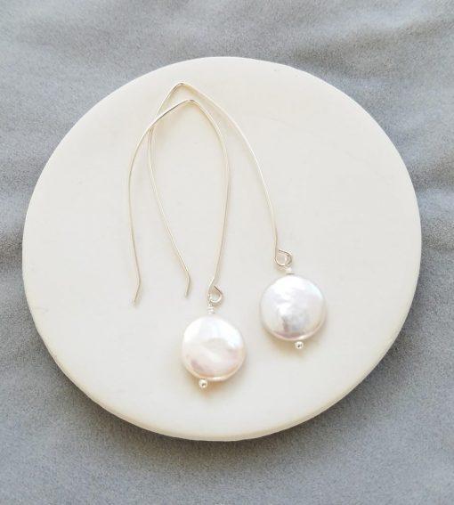 Handmade long dangle coin pearl earrings by Carrie Whelan Designs