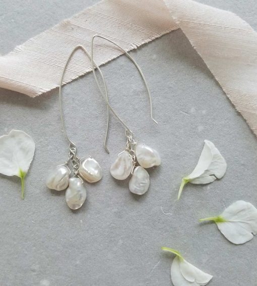 Long dangle pearl cluster earrings handcrafted in sterling silver by Carrie Whelan Designs
