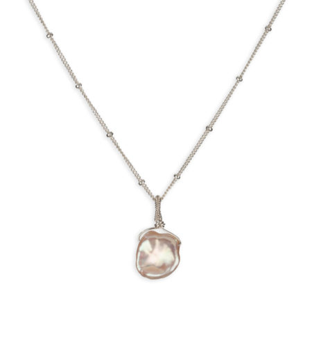 Champagne keshi pearl pendant handcrafted in sterling silver by Carrie Whelan Designs