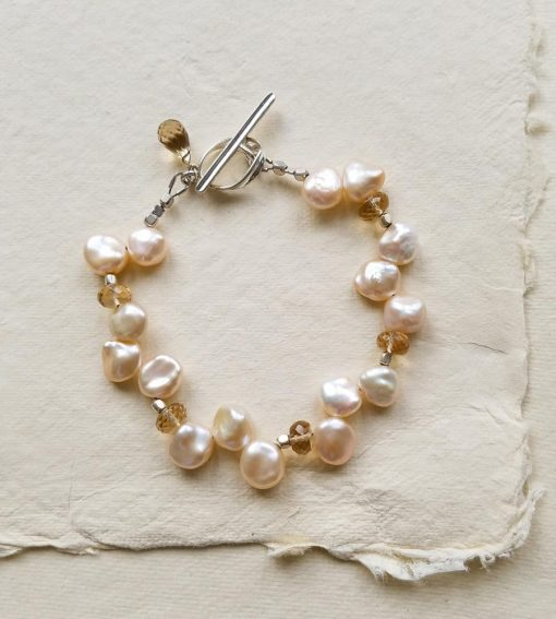 Champagne petal pearl bridal bracelet handcrafted by Carrie Whelan Designs