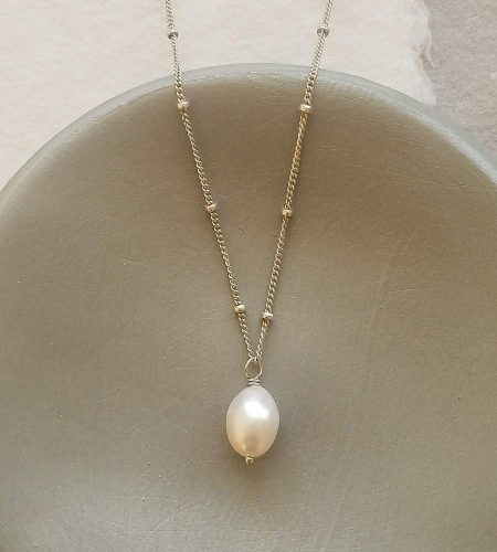 Dainty freshwater pearl pendant necklace in silver handcrafted by Carrie Whelan Designs