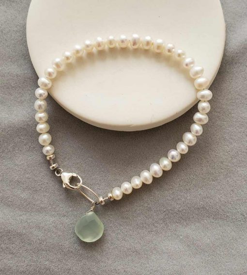 Dainty freshwater pearl bracelet with aqua dangle in silver handmade by Carrie Whelan Designs