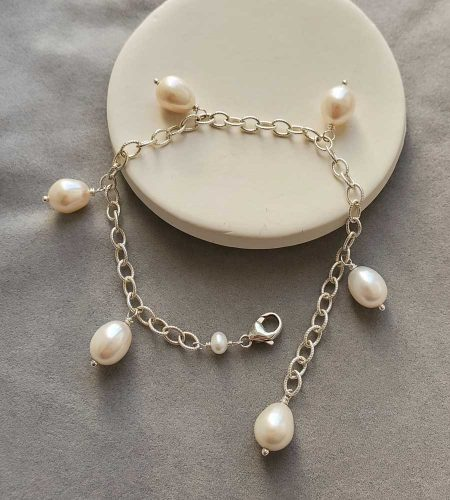 Freshwater pearl charm bracelet handmade by Carrie Whelan Designs
