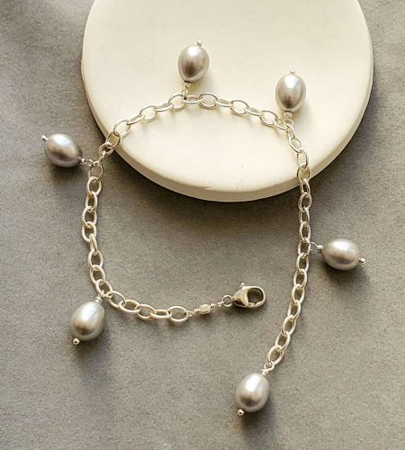 Gray freshwater pearl charm silver charm bracelet handcrafted by Carrie Whelan Designs