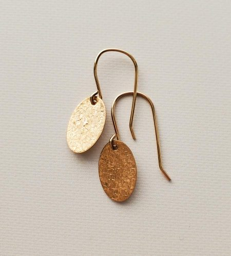Dainty gold oval earrings handmade by Carrie Whelan Designs
