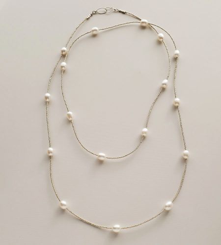 Long freshwater pearl strand necklace handmade by Carrie Whelan Designs