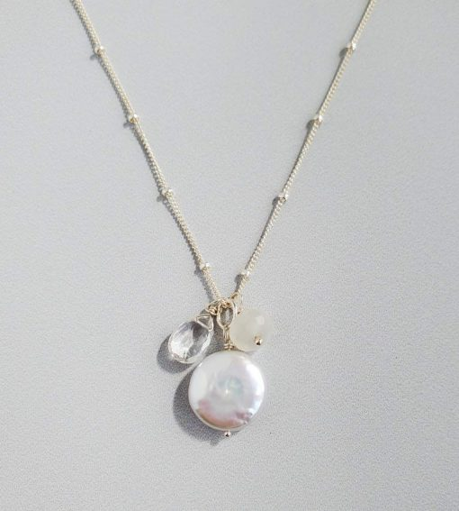 Coin pearl and moonstone cluster pendant in sterling silver handcrafted by Carrie Whelan Designs