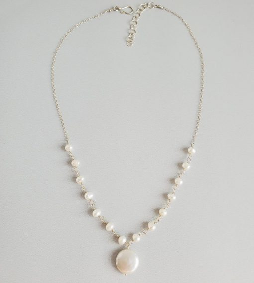 Delicate coin pearl necklace in sterling silver handmade by Carrie Whelan Designs