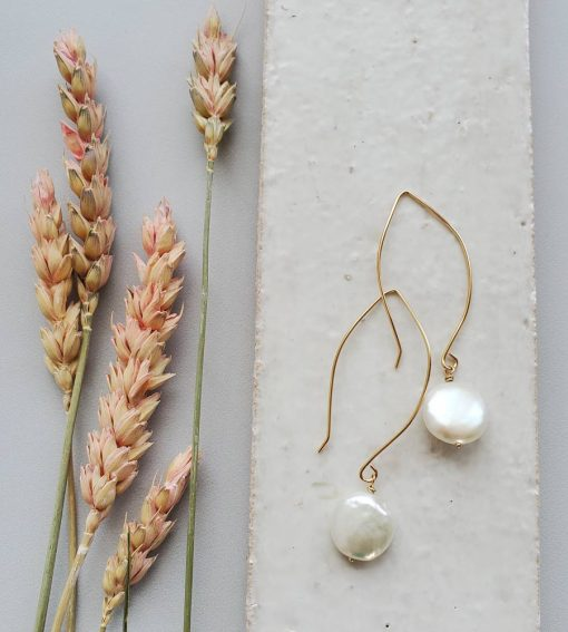 Long dangle coin pearl earrings in 14kt gold fill handcrafted by Carrie Whelan Designs